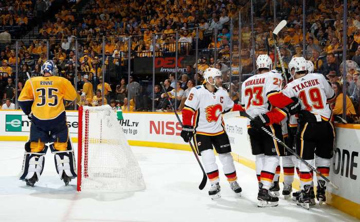 Calgary Flames score a powerplay goal against Pekka Rinne of the Nashville Predators