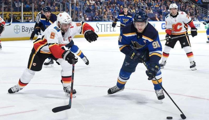 Mark Giordano of the Calgary Flames defends against Vladimir Tarasenko of the St. Louis Blues