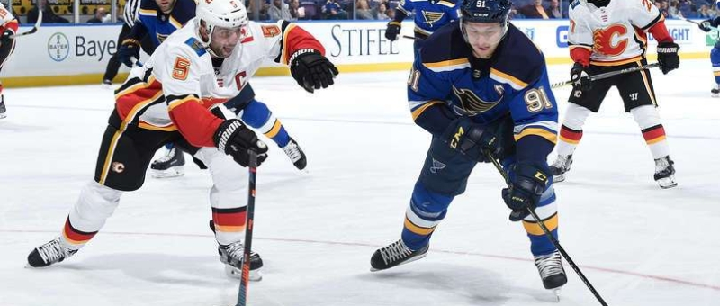 Mark Giordano of the Calgary Flames defends against Vladimir Tarasenko of the St. Louis Blues