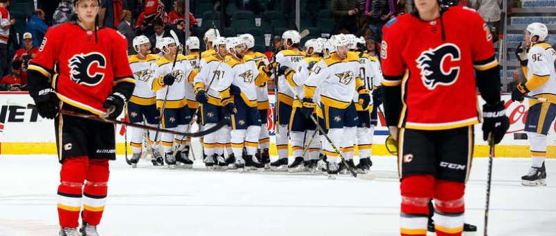 The Nashville Predators celebrate a win against the Calgary Flames at the Scotiabank Saddledome. Juuso Valimaki and Michael Stone are pictured skating off the ice.
