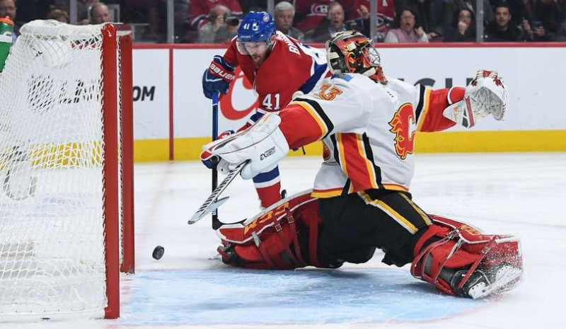MONTREAL, QC - OCTOBER 23: Paul Byron #41 of the Montreal Canadiens misses the net against goaltender David Rittich #33 of the Calgary Flames in the NHL game at the Bell Centre on October 23, 2018 in Montreal, Quebec, Canada. (Photo by Francois Lacasse/NHLI via Getty Images
