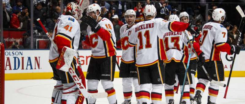 Mike Smith of the Calgary Flames celebrates with his team after winning against the Toronto Maple Leafs.