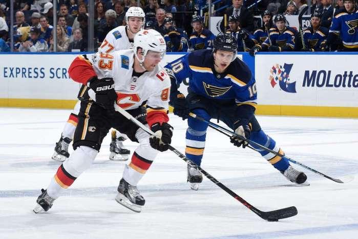 Brayden Schenn of the St. Louis Blues defends against Sam Bennett of the Calgary Flames