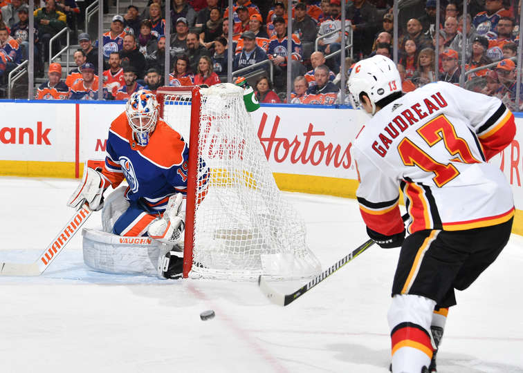 Johnny Gaudreau of the Calgary Flames takes a sharp angle shot on Mikko Koskinen of the Edmonton Oilers. December 9, 2018.