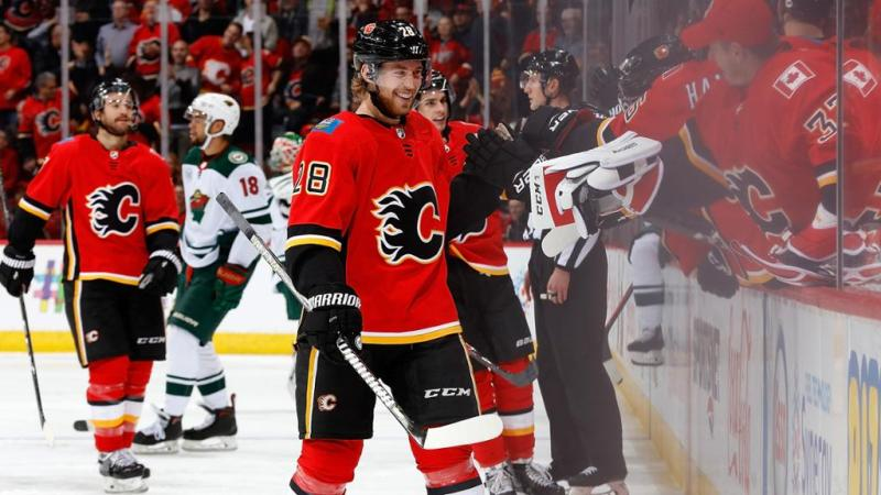 Elias Lindholm of the Calgary Flames celebrating a goal with his teammates.