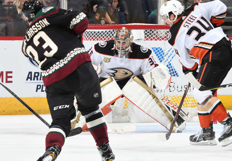 GLENDALE, AZ - OCTOBER 06: John Gibson #36 of the Anaheim Ducks gets ready to make a save on a shot by Oliver Ekman-Larsson #23 of the Arizona Coyotes at Gila River Arena on October 6, 2018 in Glendale, Arizona. (Photo by Norm Hall/NHLI via Getty Images)
