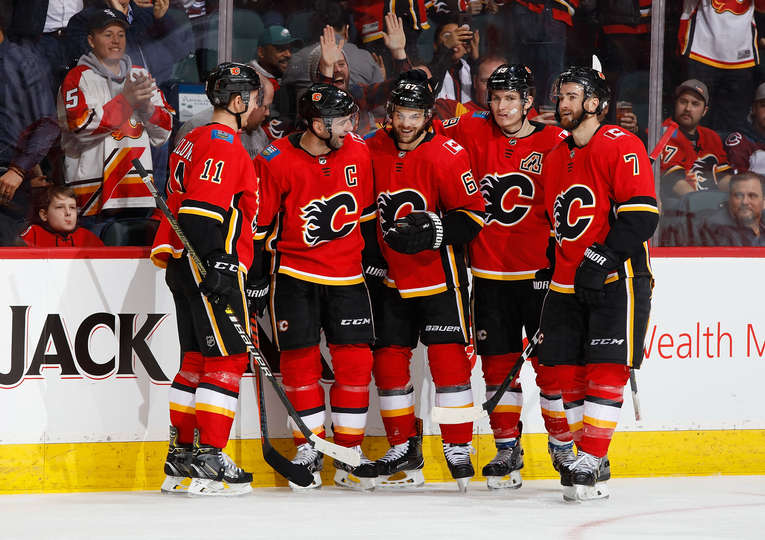 Michael Frolik #67 of the Calgary Flames celebrates with teammates after a goal against the Colorado Avalanche at Scotiabank Saddledome on January 9, 2019 in Calgary, Alberta, Canada.