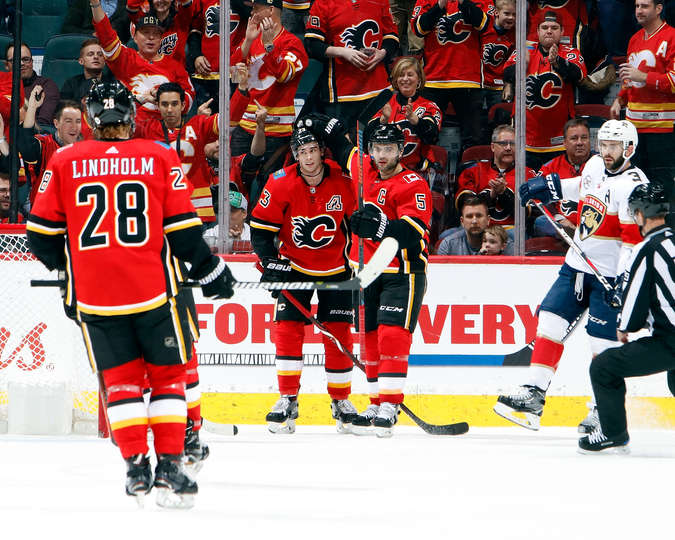 CALGARY, AB - JANUARY 11: Sean Monahan #23 and Mark Giordano #5 of the Calgary Flames celebrate a goal against the Florida Panthers during an NHL game on January 11, 2019 at the Scotiabank Saddledome in Calgary, Alberta, Canada. (Photo by Gerry Thomas/NHLI via Getty Images)