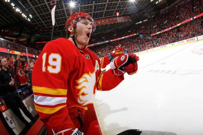 CALGARY, AB - JANUARY 18: Matthew Tkachuk #19 and teammates of the Calgary Flames celebrate a goal against the Detroit Red Wings during an NHL game on January 18, 2019 at the Scotiabank Saddledome in Calgary, Alberta, Canada. (Photo by Gerry Thomas/NHLI via Getty Images)