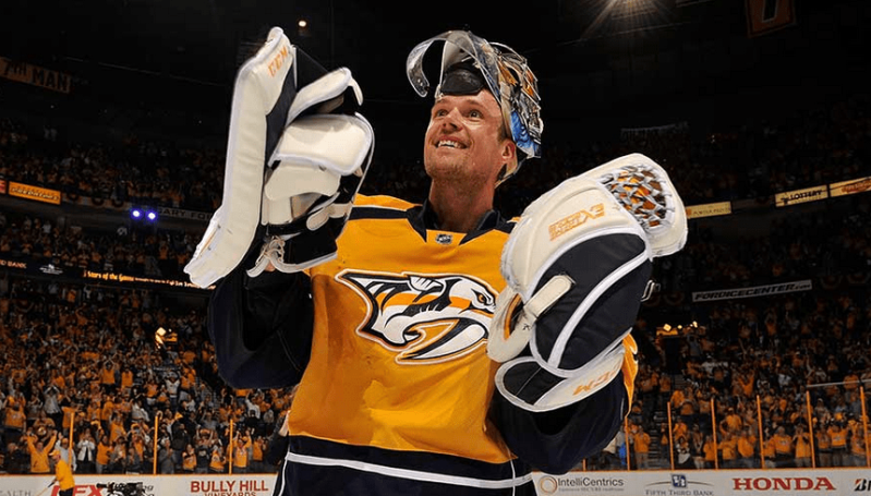 Pekka Rinne celebrates a win in Nashville