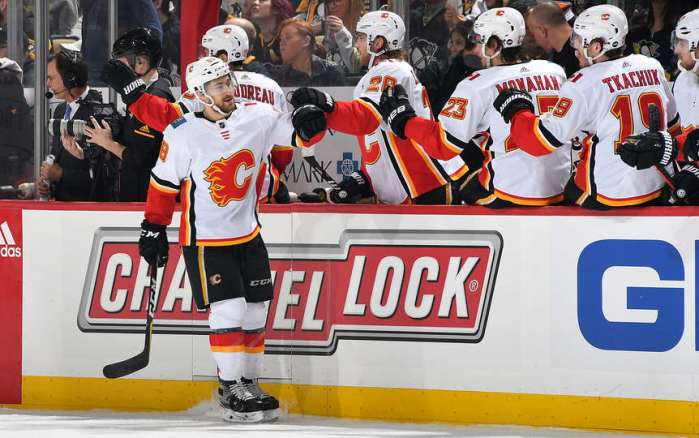 PITTSBURGH, PA - FEBRUARY 16: Andrew Mangiapane #88 of the Calgary Flames celebrates his first period against the Pittsburgh Penguins at PPG Paints Arena on February 16, 2019 in Pittsburgh, Pennsylvania. (Photo by Joe Sargent/NHLI via Getty Images)