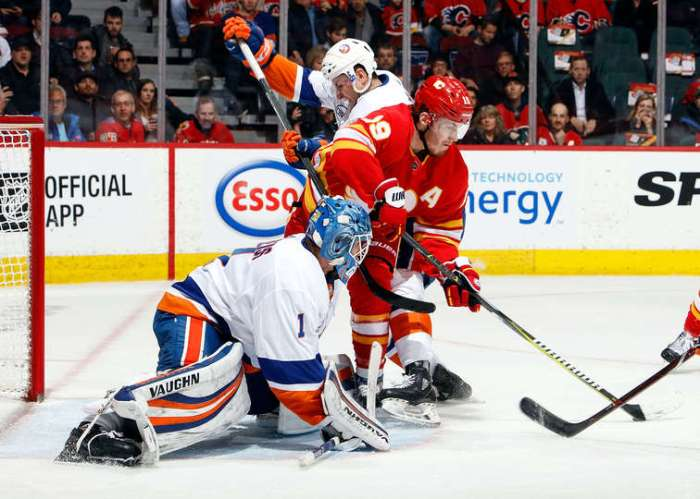 CALGARY, AB - FEBRUARY 20: Matthew Tkachuk #19 of the Calgary Flames attempts to score on Thomas Greiss #1 of the New York Islanders during an NHL game on February 20, 2019 at the Scotiabank Saddledome in Calgary, Alberta, Canada. (Photo by Gerry Thomas/NHLI via Getty Images)