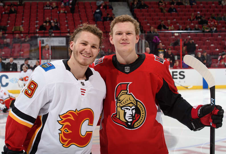OTTAWA, ON - FEBRUARY 24: Brothers Brady Tkachuk #7 of the Ottawa Senators and Matthew Tkachuk #19 the Calgary Flames pose for a photo during warm up prior to a game at Canadian Tire Centre on February 24, 2019 in Ottawa, Ontario, Canada. (Photo by Matt Zambonin/NHLI via Getty Images)