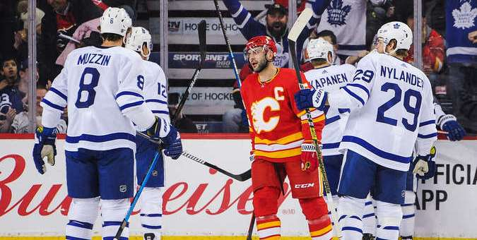 CALGARY, AB - MARCH 4: The Toronto Maple Leafs celebrate after Tyler Ennis #63 (not pictured) scored against the Calgary Flames of during an NHL game at Scotiabank Saddledome on March 4, 2019 in Calgary, Alberta, Canada. (Photo by Derek Leung/Getty Images)