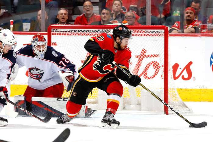 CALGARY, AB - MARCH 19: Andrew Mangiapane #88 of the Calgary Flames scores against Sergei Bobrovsky #72 of the Columbus Blue Jackets during an NHL game on March 19, 2019 at the Scotiabank Saddledome in Calgary, Alberta, Canada. (Photo by Gerry Thomas/NHLI via Getty Images)