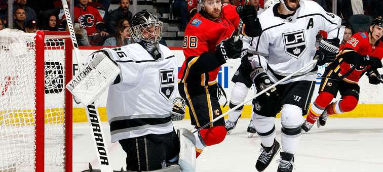 CALGARY, AB - MARCH 25: Andrew Mangiapane #88 of the Calgary Flames and Drew Doughty #8 of the Los Angeles Kings compete for position in front of Jack Campbell #36 of the Los Angeles Kings during an NHL game where the Calgary Flames hosted the Los Angeles Kings on March 25, 2019 at the Scotiabank Saddledome in Calgary, Alberta, Canada. (Photo by Gerry Thomas/NHLI via Getty Images)