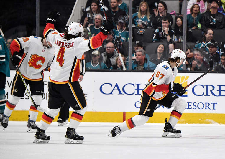 SAN JOSE, CA - MARCH 31: Michael Frolik #67 and Rasmus Andersson #4 of the Calgary Flames celebrate scoring a goal at SAP Center on March 31, 2019 in San Jose, California (Photo by Brandon Magnus/NHLI via Getty Images)
