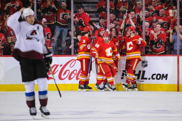 CALGARY, AB - APRIL 11: Andrew Mangiapane #88 (C) of the Calgary Flames celebrates with his team after scoring his team's first goal against the Colorado Avalanche in Game One of the Western Conference First Round during the 2019 NHL Stanley Cup Playoffs at Scotiabank Saddledome on March 15, 2019 in Calgary, Alberta, Canada. (Photo by Derek Leung/Getty Images)