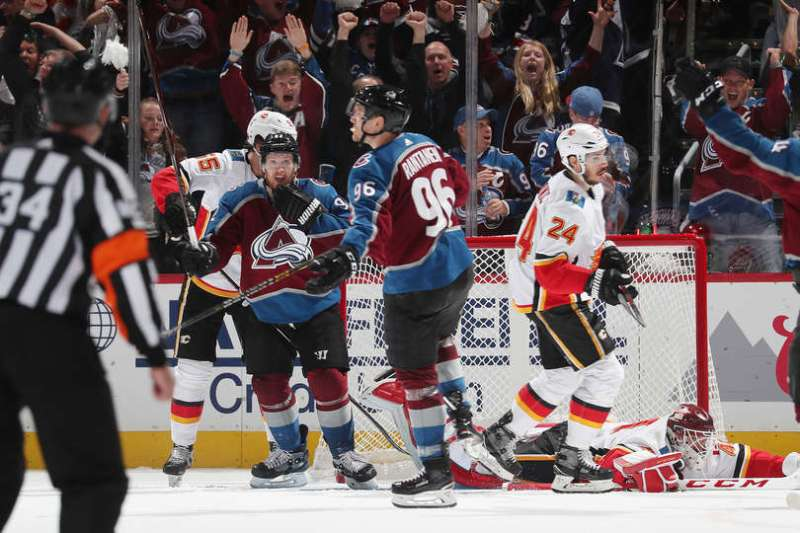 DENVER, CO - APRIL 17: Mikko Rantanen #96 of the Colorado Avalanche celebrates after scoring the game winning goal against the Calgary Flames in Game Four of the Western Conference First Round during the 2019 NHL Stanley Cup Playoffs at the Pepsi Center on April 17, 2019 in Denver, Colorado. The Avalanche defeated the Flames 3-2 in overtime. (Photo by Michael Martin/NHLI via Getty Images)