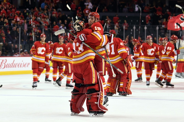 Nov 3, 2018; Calgary, Alberta, CAN; Calgary Flames goalie David Rittich (33) and left wing Matthew Tkachuk (19) celebrate the win over the Chicago Blackhawks at Scotiabank Saddledome. Flames won 5-3. Mandatory Credit: Candice Ward-USA TODAY Sports