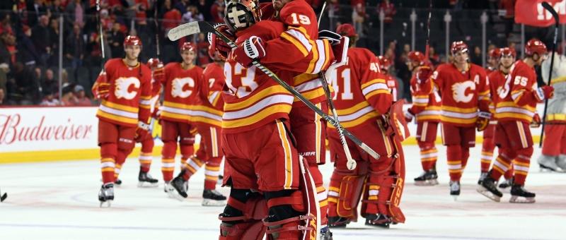 Nov 3, 2018; Calgary, Alberta, CAN; Calgary Flames goalie David Rittich (33) and left wing Matthew Tkachuk (19) celebrate the win over the Chicago Blackhawks at Scotiabank Saddledome. Flames won 5-3. Mandatory Credit: Candice Ward-USA TODAY Sports