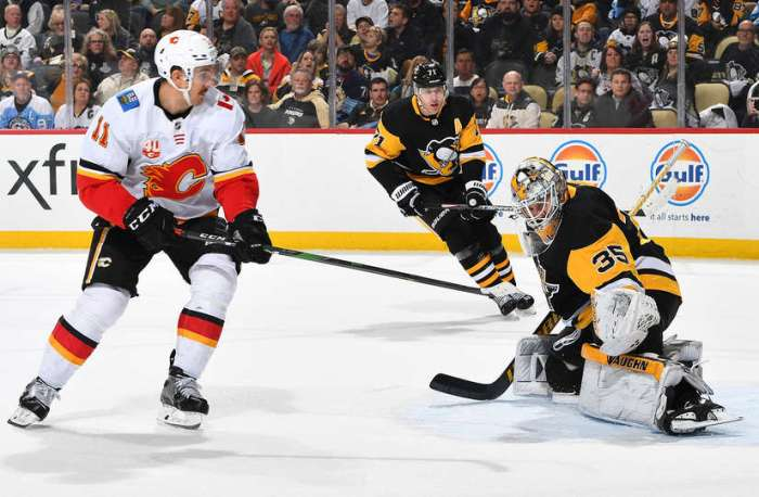 PITTSBURGH, PA - NOVEMBER 25: Tristan Jarry #35 of the Pittsburgh Penguins makes a save on a shot by Mikael Backlund #11 of the Calgary Flames at PPG PAINTS Arena on November 25, 2019 in Pittsburgh, Pennsylvania. (Photo by Joe Sargent/NHLI via Getty Images)