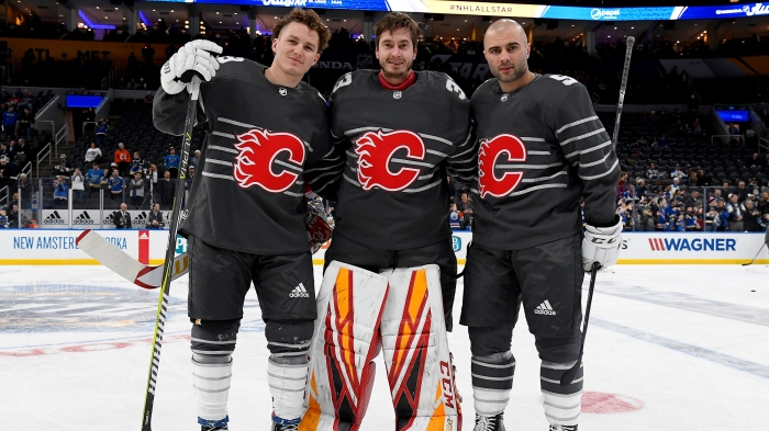 Matthew Tkachuk, David Rittich, and Mark Giordano pose for a photo at the 2020 All-Star Game in St. Louis
