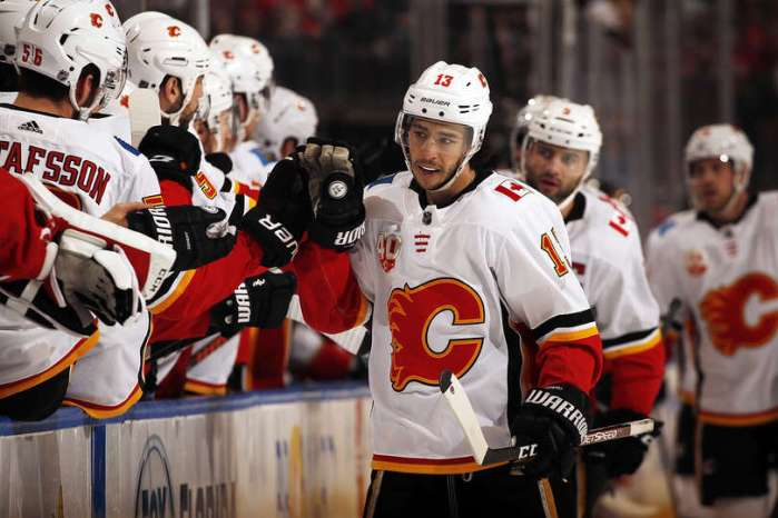 SUNRISE, FL - MARCH 1: Johnny Gaudreau #13 of the Calgary Flames celebrates his goal with teammates during the first period against the Florida Panthers at the BB&T Center on March 1, 2020 in Sunrise, Florida. (Photo by Eliot J. Schechter/NHLI via Getty Images)