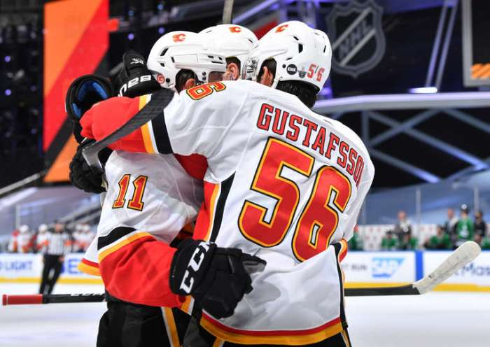 EDMONTON, ALBERTA - AUGUST 18: Mikael Backlund #11 of the Calgary Flames celebrates scoring against the Dallas Stars with Noah Hanifin #55 and Erik Gustafsson #56 during the first period of Game Five of the Western Conference First Round of the 2020 NHL Stanley Cup Playoff at Rogers Place on August 18, 2020 in Edmonton, Alberta. (Photo by Andy Devlin/NHLI via Getty Images)