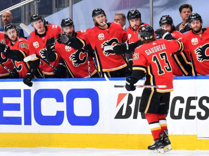 EDMONTON, ALBERTA - AUGUST 20: Johnny Gaudreau #13 of the Calgary Flames celebrates his power play goal against the Dallas Stars with teammates during the first period of Game Six of the Western Conference First Round of the 2020 NHL Stanley Cup Playoffs at Rogers Place on August 20, 2020 in Edmonton, Alberta. (Photo by Andy Devlin/NHLI via Getty Images)