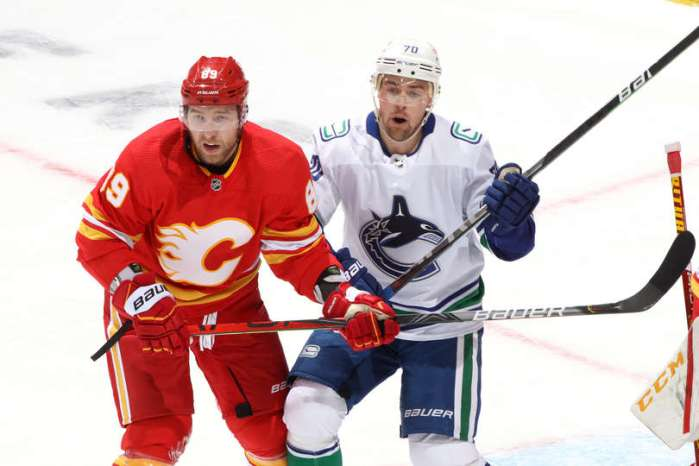CALGARY, ALBERTA - JANUARY 18: Nikita Nesterov #89 of the Calgary Flames skates against Tanner Pearson #70 of the Vancouver Canucks at Scotiabank Saddledome on January 18, 2021 in Calgary, Alberta. (Photo by Gerry Thomas/NHLI via Getty Images)