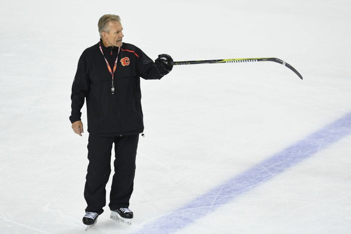 Geoff Ward directs traffic at Flames practice