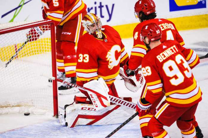CALGARY, AB - FEBRUARY 19: David Rittich #33 of the Calgary Flames could no stop the shot of Jesse Puljujarvi #13 (not pictured) of the Edmonton Oilers during an NHL game at Scotiabank Saddledome on February 19, 2021 in Calgary, Alberta, Canada. (Photo by Derek Leung/Getty Images)